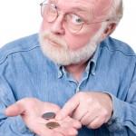 Монеты на руке пенсионера